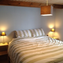 Double bed in Chambre la Foret