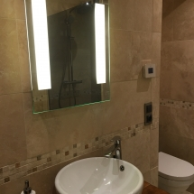 Side lit wall mirror