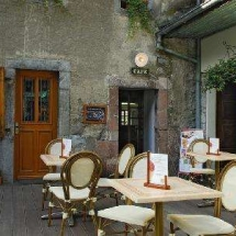 La Pension de Savoie outdoor seating with views of the Abbey